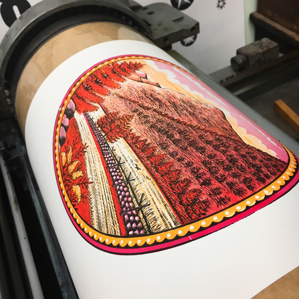 Three color print from antique wood engravings coming around the drum at the GramLee Collection at WVU - Morgantown, WV
