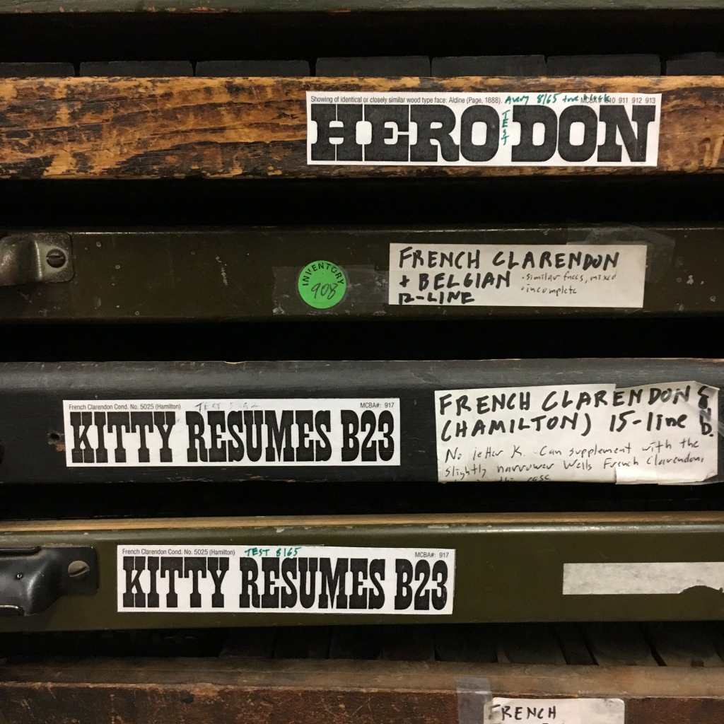Wood type specimen tags on the outside of typecases at the Minnesota Center for Book Arts - Minneapolis, MN